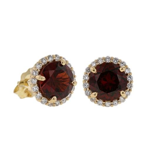 round garnet gemstones set in halo of white diamond rounds in yellow gold