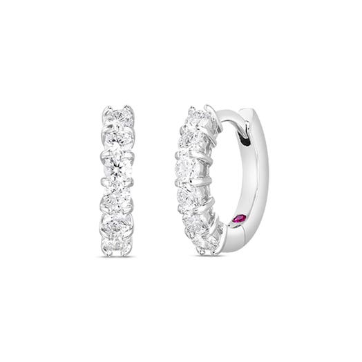 white gold diamond hoop earrings with 6 round diamonds on each front of earring