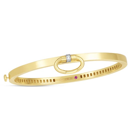yellow gold band with diamond accented loop to hold a charm