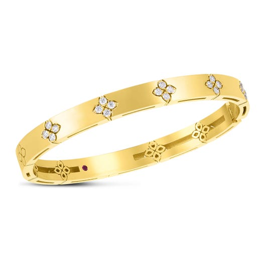 yellow gold bangle with diamond accented floral motifs