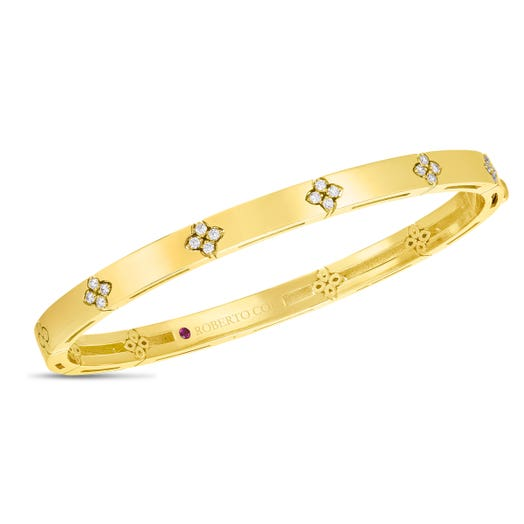 yellow gold band with diamond accented floral motifs
