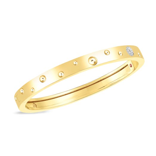 yellow gold bangle with diamond accents