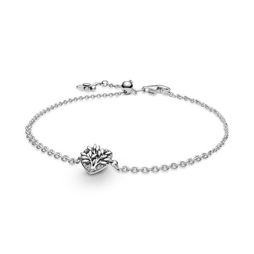 chain bracelet in silver with heart shaped accent with stones and leaf detailed tree