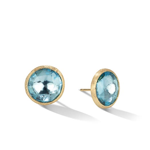 yellow gold stud earrings with round blue topaz centers