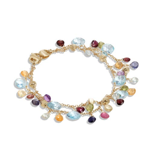 yellow gold double strand bracelet with multi colored and multi sized gemstones