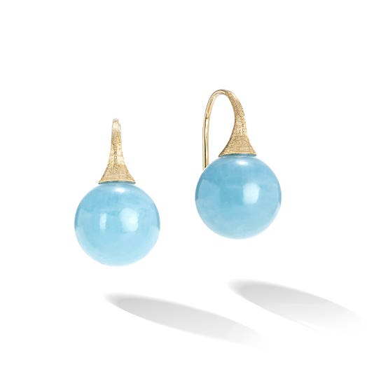 yellow gold earrings with french wire and round blue gemstones