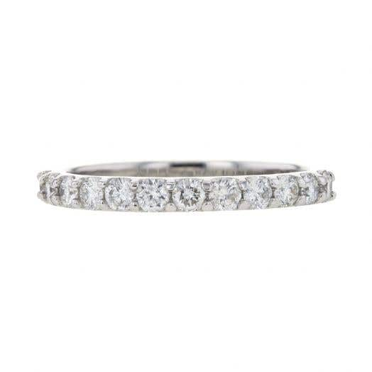 white gold band with shared prong set white diamond rounds