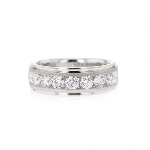 white gold band with seven round-cut diamonds and an etched design