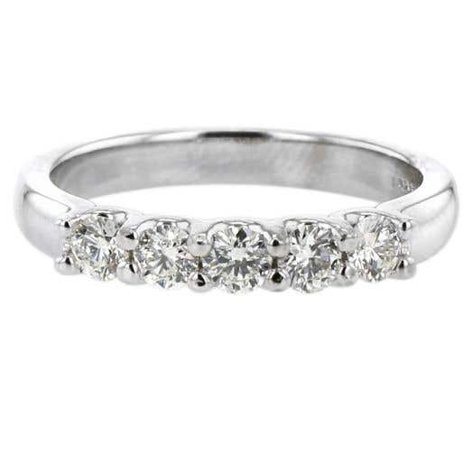 five white diamond rounds set on white gold band