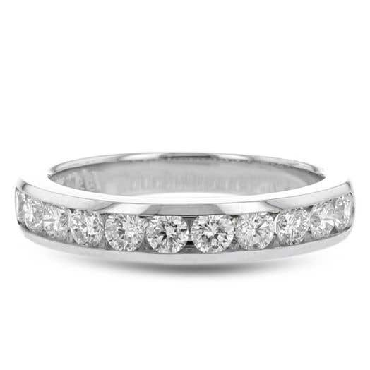 white gold band with channel set diamond rounds
