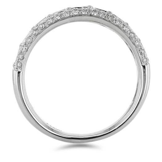white gold band with princess cut diamonds surrounded in halos of white diamond rounds