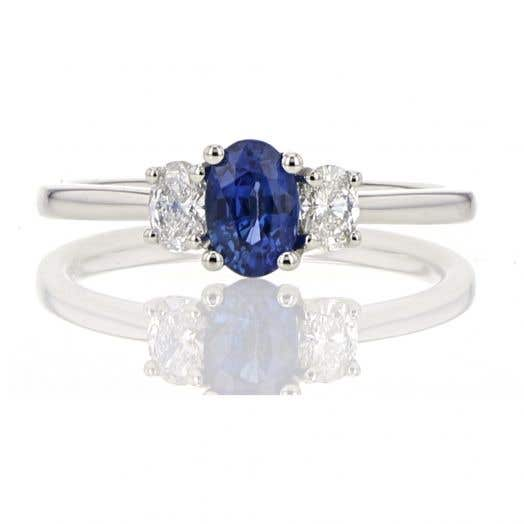 Three-Stone Oval Sapphire and Diamond Ring in Platinum, TDW.26