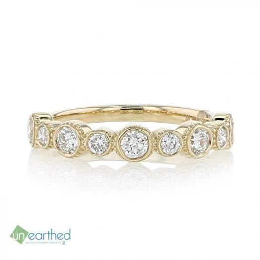 yellow gold band with diamond rounds that alternate in size to create a bubble effect