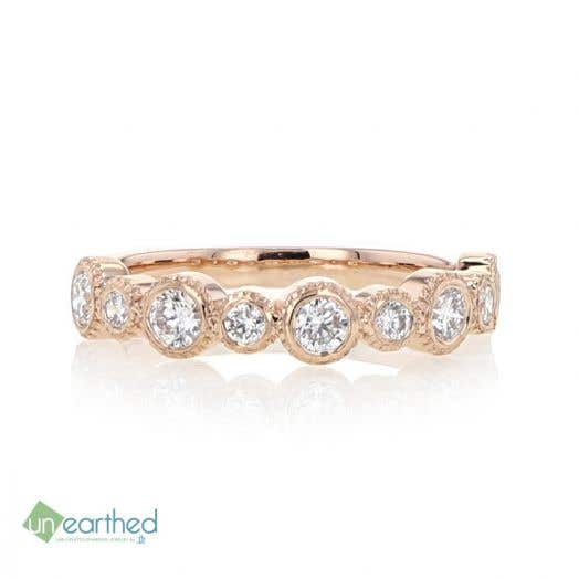 rose gold bubble stacking ring with white diamond rounds that atlernate in size