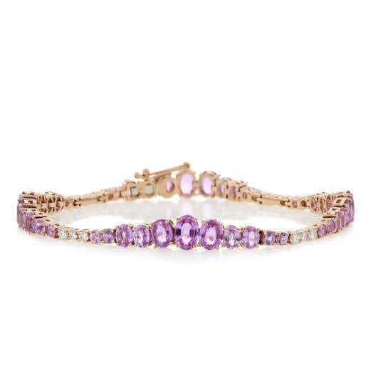 rose gold bracelet with oval and round cut sapphires in graduating sizes with diamond accents