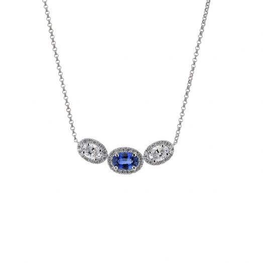 oval cut sapphire gemstone with diamond halo flanked by two oval cut diamond stones with halos supended from white gold chain link
