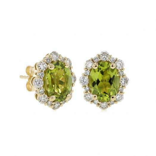 oval-cut peridot stones set in diamond halo that alternates in size for flowered effect set on yellow gold studs