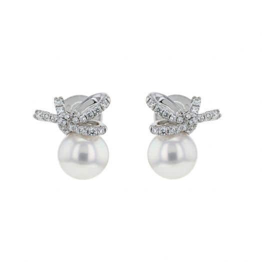 pearl earings on white gold posts with diamond accented bow details