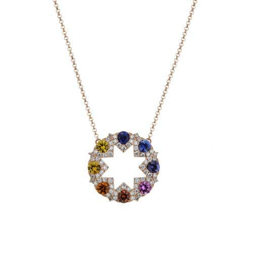 rose gold chain with circle pendant with open design featuring a star shape, multi colored sapphire rounds and white diamond round accents