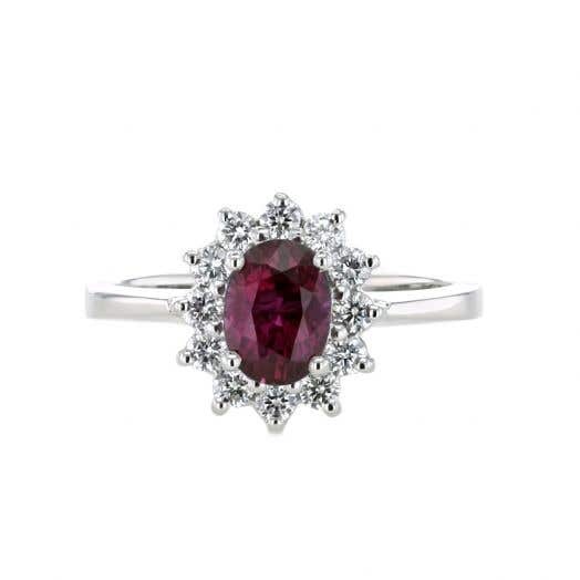 Oval-Cut Ruby Ring with Diamond Starburst Halo in Platinum