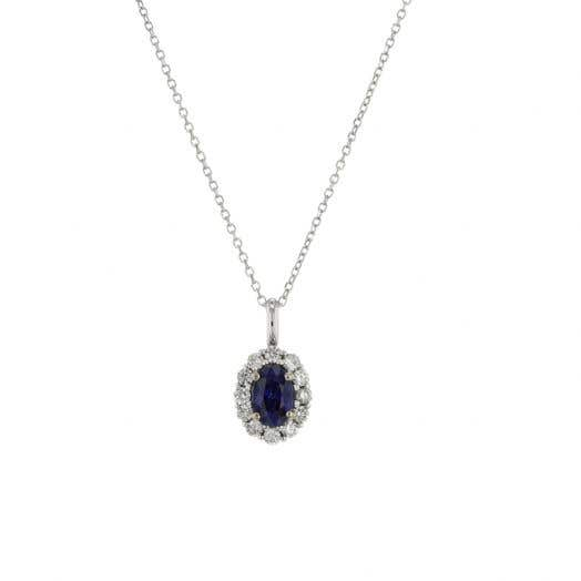 oval cut sapphire gemstone set in halo of white diamonds suspended from white gold chain