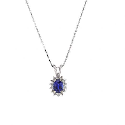 oval-cut blue sapphire with starburst diamond halo suspended from split bale and white gold box chain