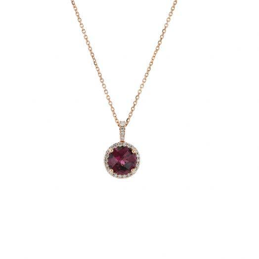 rose gold chain with round garnet gemstone set in halo of white diamond rounds that extend onto the bale
