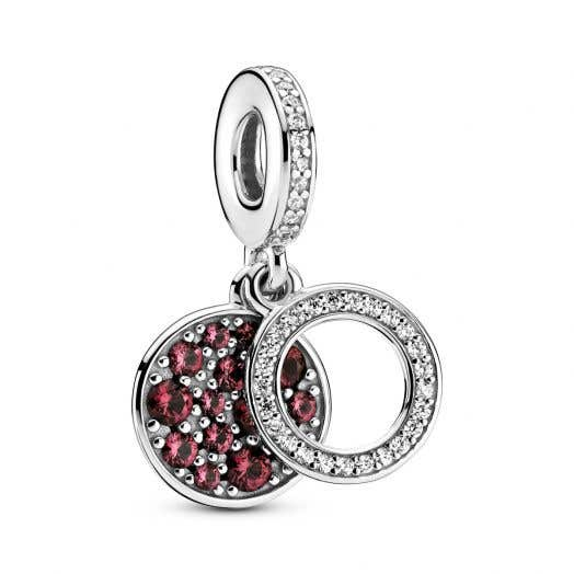 silver dangle charm with cubic zirconia accents and red round stones accenting circle dangle