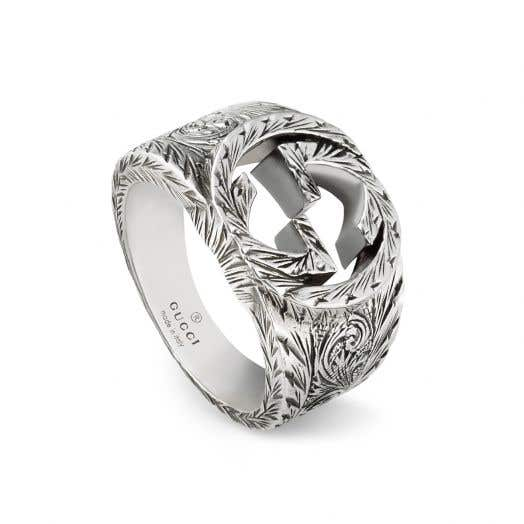 gucci band ring with interlocking g motif and etched detailing in silver